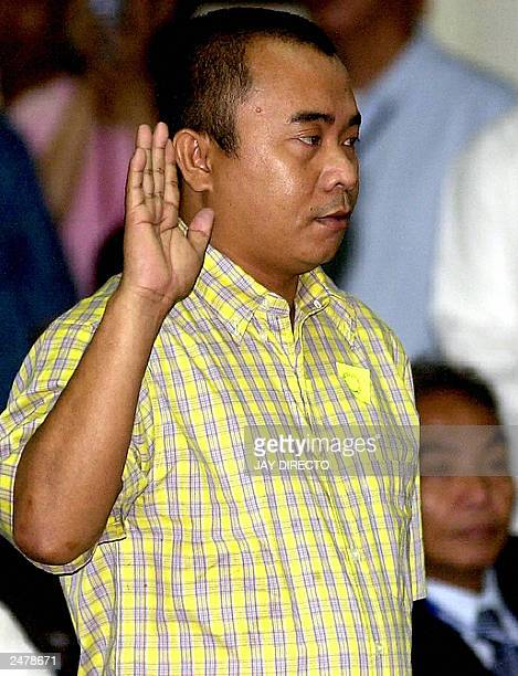 Star witness Eugenio Mahusay is sworn in at the start of a Senate hearing into allegations 02 September 2003 that Jose Miguel Arroyo the husband of...