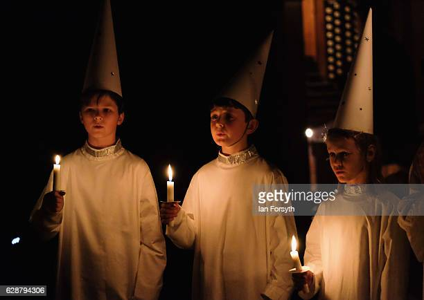 Starboys from the Vaxholm Boys Quintet near Stockholm Sweden form part of the procession during the Swedish Sankta Lucia Festival of Light service at...