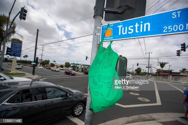 Starbucks apron filled with written memorial notes hangs on the street sign at the accident scene after fellow Starbucks employees and friends...