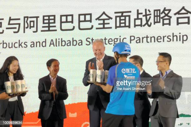 Starbucks CEO Kevin Johnson and Chief Executive Officer of Alibaba Group Holding Ltd Daniel Zhang receive the Starbucks coffee delivery during the...