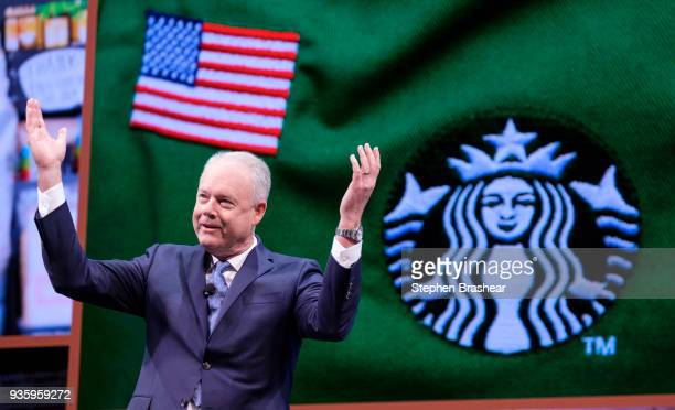 Starbucks CEO Kevin Johnson gestures while speaking during the Starbucks annual shareholders meeting at McCaw Hall on March 21 2018 in Seattle...