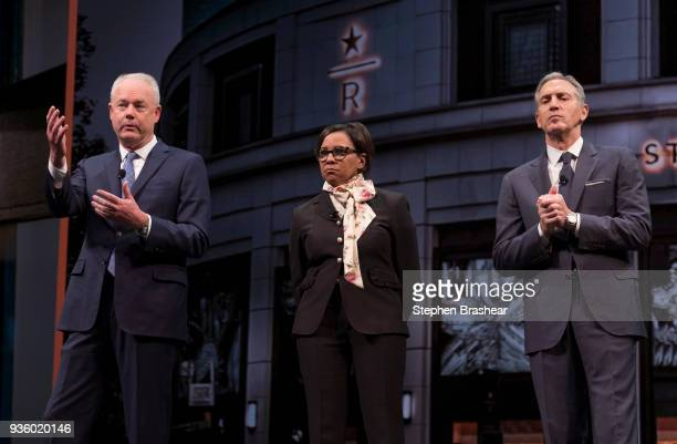 Starbucks CEO Kevin Johnson left answers questions during the Starbucks Annual Shareholders Meeting while Starbucks Chief Operating Officer Roz...