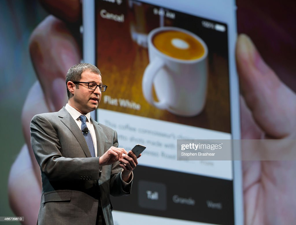 Starbucks chief digital officer Adam Brotman demonstrating mobile order and pay on the the company's app during the Starbucks annual shareholders meeting March 18, 2015 in Seattle, Washington. Brotman also introduced a new Starbucks delivery service.