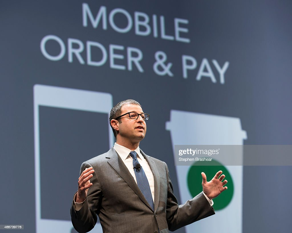 Starbucks chief digital officer Adam Brotman talks about the company's new mobile order and pay program during Starbucks annual shareholders meeting March 18, 2015 in Seattle, Washington. Brotman also talked about a delivery service.