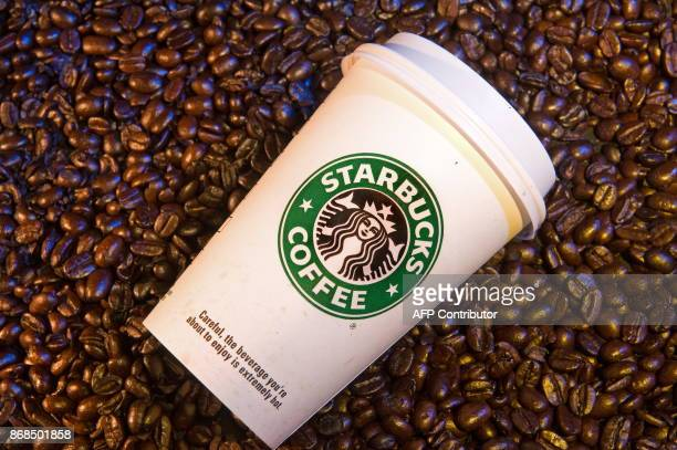 Starbucks coffee and beans are seen in this photo taken August 12 2009 AFP Photo/Paul J Richards / AFP PHOTO / Paul J RICHARDS