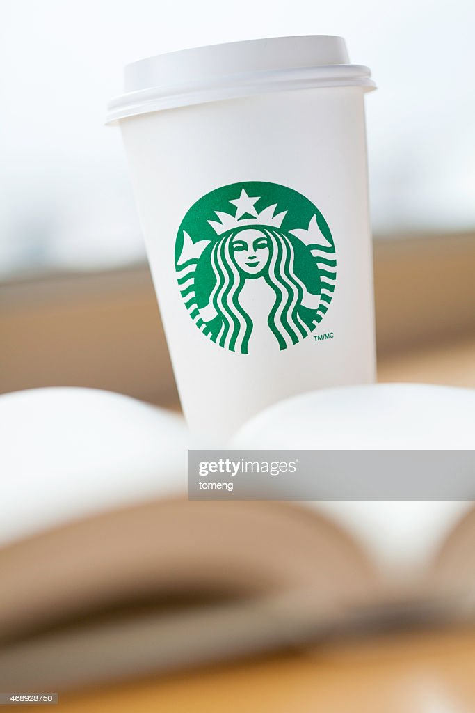 Starbucks Coffee And Open Book Stock Photo Getty Images