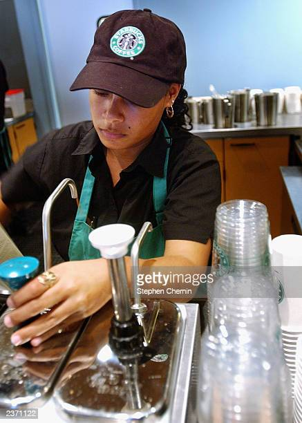 Starbucks Coffee barrista readies a beverage for a customer in the new 42nd Street store August 5 2003 in New York City The Seattlebased coffee...