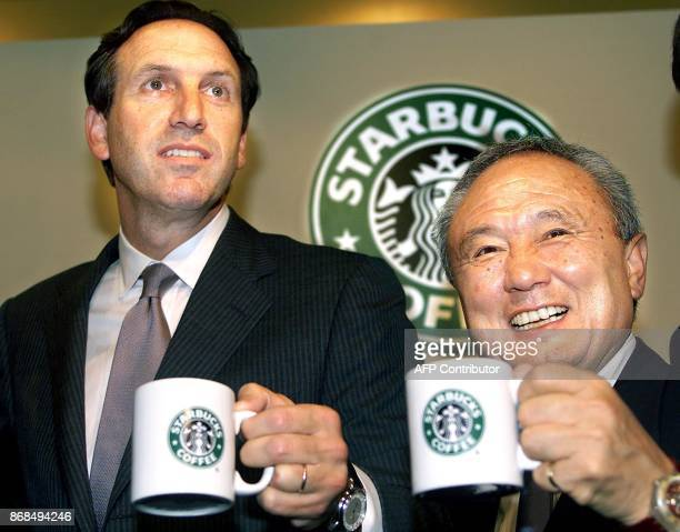 Starbucks Coffee chairman Howard Schultz and Starbucks Japan CEO Yuji Tsunoda raise mugs to celebrate the listing of Starbucks Japan on the Nasdaq...