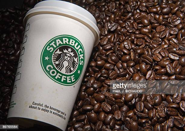 A Starbucks coffee cup and beans are seen in this photo taken August 12 2009 in Washington DC AFP Photo/Paul J Richards