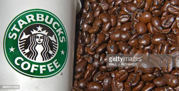 A Starbucks coffee cup and Starbucks coffee beans are seen in this photo taken August 12 2009 AFP Photo/Paul J Richards / AFP PHOTO / Paul J RICHARDS
