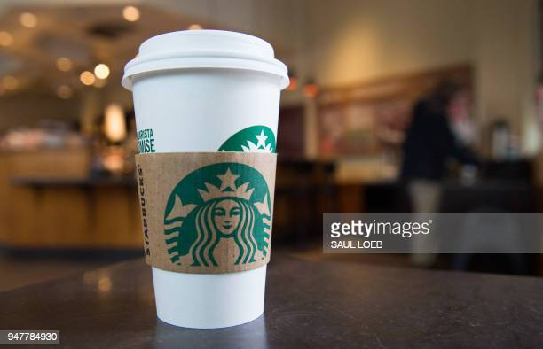 A Starbucks coffee cup is seen inside a Starbucks Coffee shop in Washington DC April 17 following the company's announcement that they will close...
