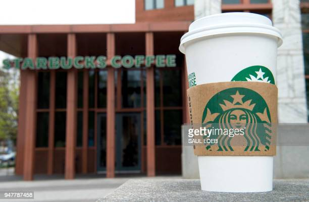 A Starbucks coffee cup is seen outside a Starbucks Coffee shop in Washington DC April 17 following the company's announcement that they will close...