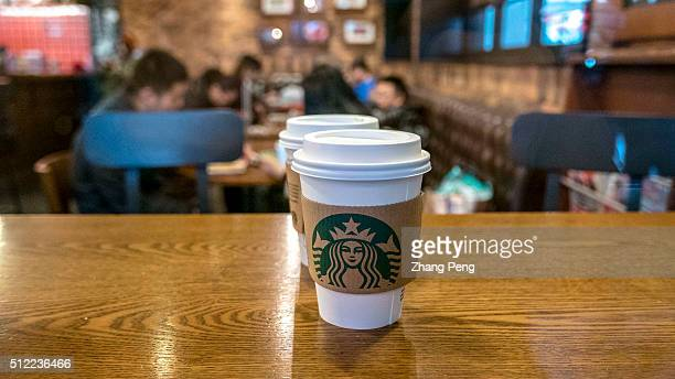 Starbucks coffee cup on the table in a Starbucks coffee house Starbucks already has nearly 2000 stores in mainland China and plans to have 3400 by...