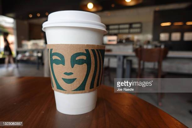 Starbucks coffee cup sits on a table as the company reported supply shortages at some coffee shops on June 11, 2021 in Miami, Florida. The coffee...