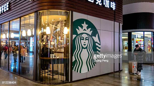 Starbucks coffee house in Beijing south railway station Starbucks already has nearly 2000 stores in mainland China and plans to have 3400 by 2019...