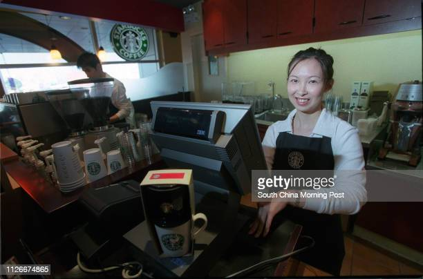 Starbucks Coffee Master Joey Wong working at the World Trade Centre branch in Causeway Bay 09 January 2003