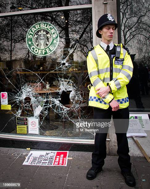 Starbucks coffee shop in Mayfair Central London is vandalised by antiglobilisation anarchists during a march against government cuts A window is...
