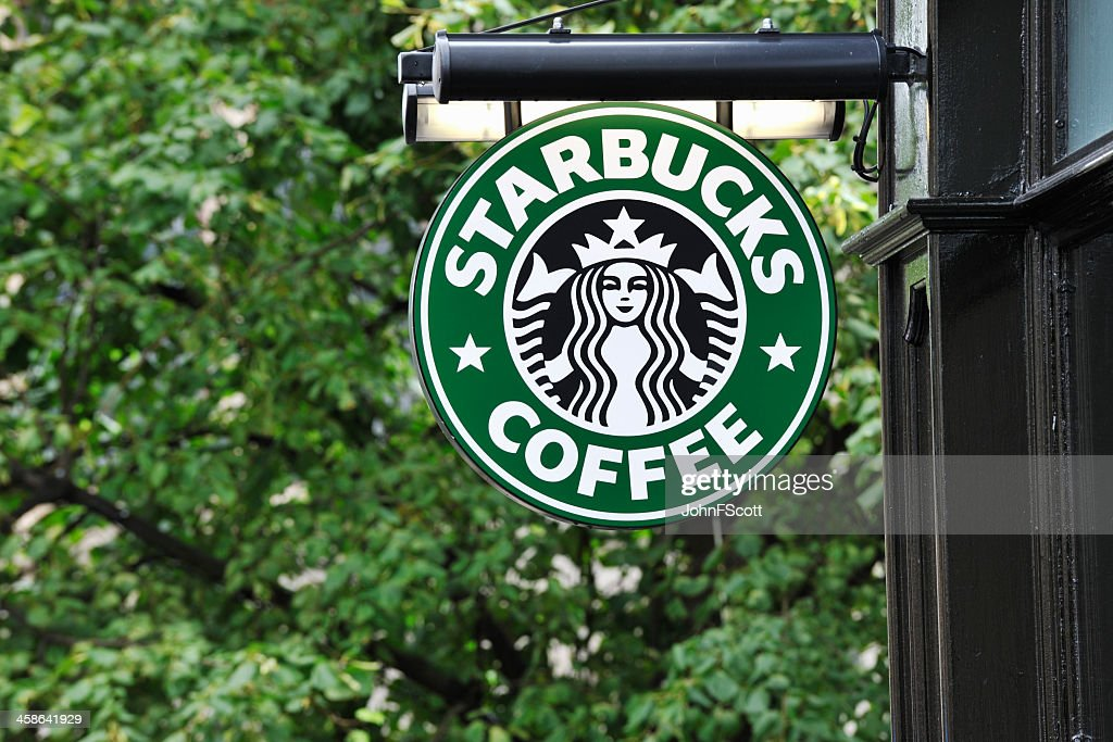 Starbucks coffee sign hanging outside a shop : Stock Photo