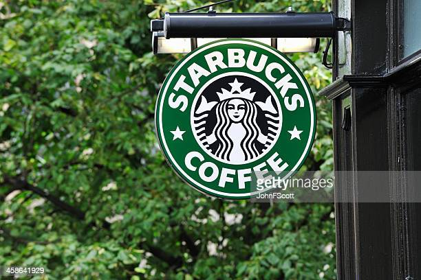 Starbucks coffee sign hanging outside a shop