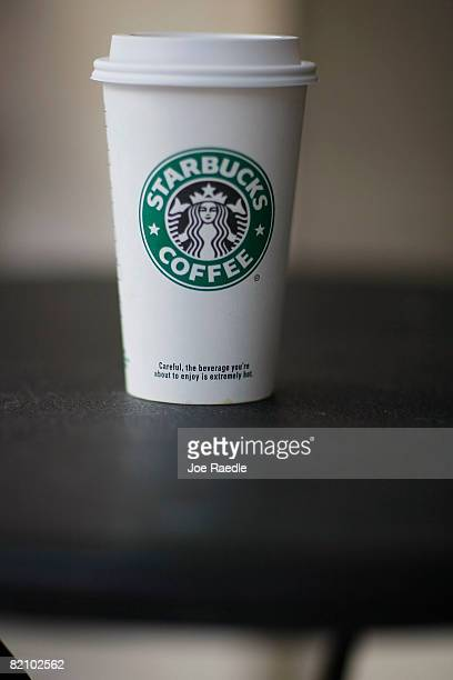 A Starbucks coffee sits on a table at a Starbucks store February 25 2008 in Miami Florida In an effort to cut costs the coffee chain announced July...
