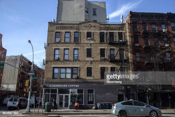 A Starbucks Corp coffee shop sits in the Kushner Cos 49 1/2 1st Avenue apartment building in the East Village neighborhood of New York US on Sunday...