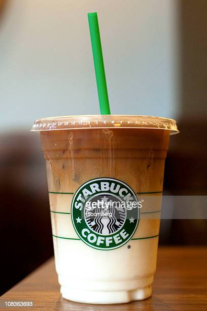 A Starbucks Corp iced caramel macchiato is displayed for a photograph at a Starbucks coffee shop in San Francisco California US on Tuesday Jan 25...