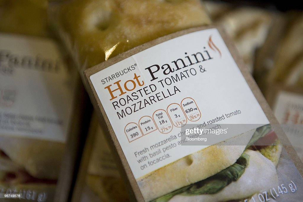 A Starbucks Corp. new low calorie roasted tomato and mozzarella hot panini sandwich is arranged for a photograph in New York, U.S., on Wednesday, Jan. 13, 2010. New Yorkers were more inclined to buy coffee from Starbucks Corp., especially from stores near a Dunkin' Donuts outlet, after restaurant chains were required to display calorie counts on products, researchers found. Photographer: Ramin Talaie/Bloomberg via Getty Images