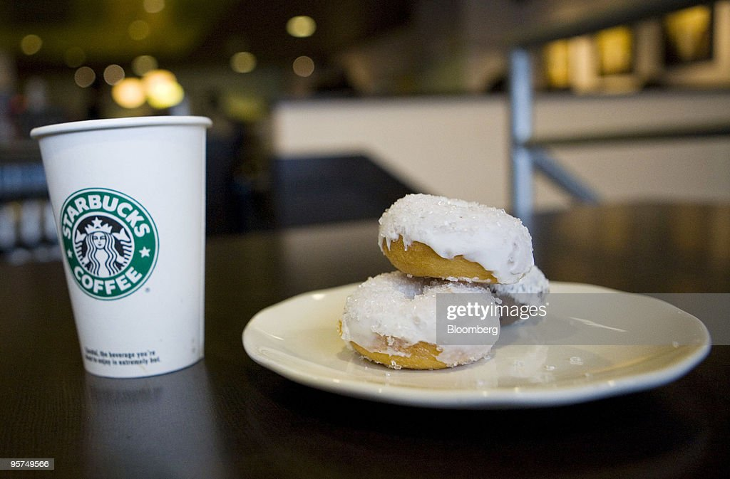 A Starbucks Corp. new low calorie vanilla latte and mini sparkle doughnuts are arranged for a photograph in New York, U.S., on Wednesday, Jan. 13, 2010. New Yorkers were more inclined to buy coffee from Starbucks Corp., especially from stores near a Dunkin' Donuts outlet, after restaurant chains were required to display calorie counts on products, researchers found. Photographer: Ramin Talaie/Bloomberg via Getty Images