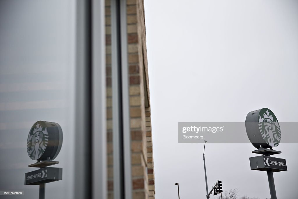 Starbucks Corp. signage is reflected on the window of a coffee shop in Peoria, Illinois, U.S., on Wednesday, Jan. 25, 2017. Starbucks Corp. is expected to release earnings figures on January 26. Photographer: Daniel Acker/Bloomberg via Getty Images