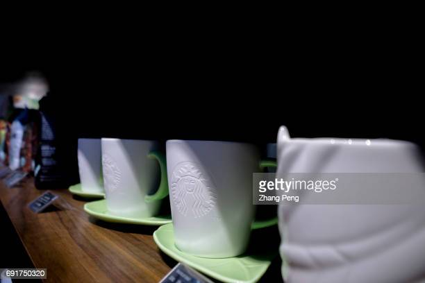 Starbucks cups on shelf In the second quarter of 2017 Starbucks opened its stores to five new cities in China As of now Starbucks China has 2628...
