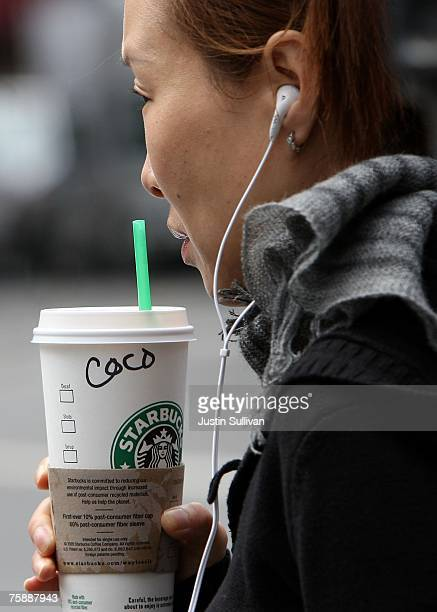 Starbucks customer holds a coffee drink as she leaves a Starbucks store July 31, 2007 in San Francisco, California. With dairy prices reaching record...