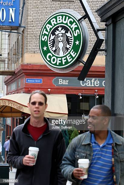 Starbucks customers leave a Starbucks store July 31, 2007 in San Francisco, California. With dairy prices reaching record highs, Starbucks announced...