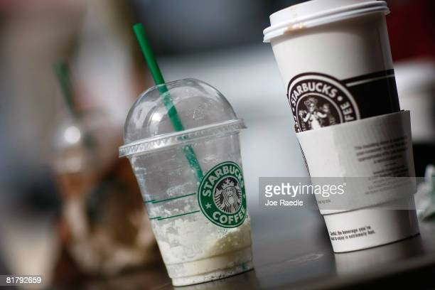 Starbucks drinks sit on a table outside a store on the day that Starbucks Corp said that it plans to close 600 companyoperated stores in the United...