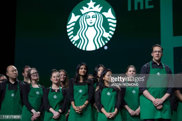 Starbucks employees are pictured on stage at the Annual Meeting of Shareholders in Seattle Washington on March 20 2019