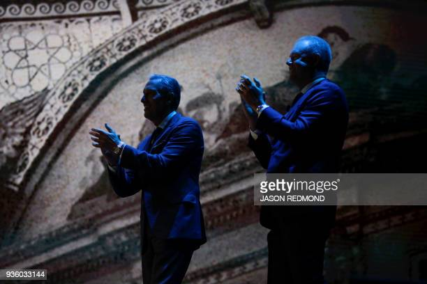 Starbucks Executive Chairman Howard Schultz and President and Chief Executive Officer Kevin Johnson applaud following a performance by Accademia...