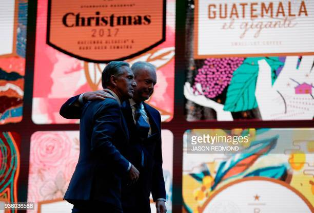 Starbucks Executive Chairman Howard Schultz and President and Chief Executive Officer Kevin Johnson leave the stage at the Starbucks Annual Meeting...