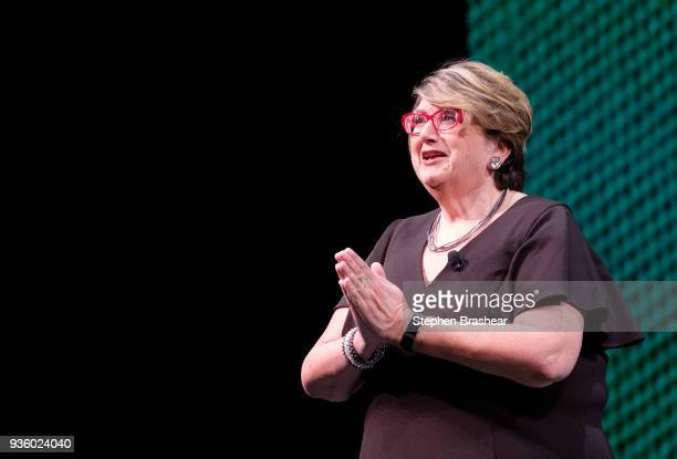 Starbucks executive vice presiden and chief partner officer Lucy Helm speaks during the Starbucks Annual Shareholders Meeting at McCaw Hall on March...