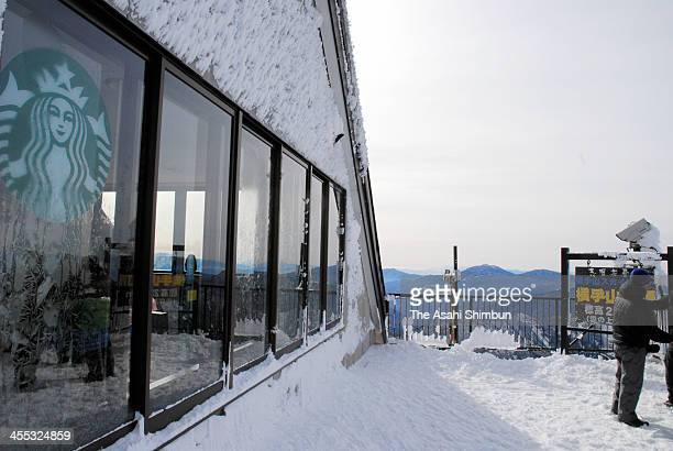 A Starbucks franchise shop is seen on the top of Mount Yokoteyama in Shiga Kogen prior to the opening on December 9 2013 in Nagano Japan The...