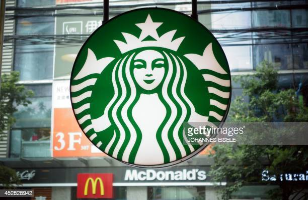 A Starbucks logo is pictured next to a McDnald's restaurant on July 28 2014 in Shanghai Some McDonald's restaurants in China have yanked their...