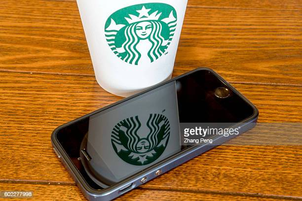 Starbucks logo reflected on mobile phone During the third quarter 2016 Starbucks China had $7682 million in sales a growth of 17% compared to the...