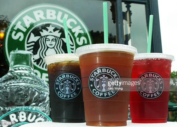 Starbucks' new iced coffee and tea beverages are displayed during a promotion July 2 2003 outside a Starbucks coffee shop at Dupont Circle in...