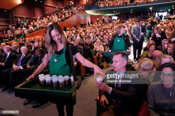 Starbucks partners pass out coffee to shareholders for a tasting during Starbucks' annual shareholders meeting at McCaw Hall on March 21 2018 in...