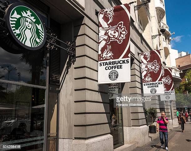 Starbucks Plaza Canovas del Castillo in front of Neptune fountain in Madrid Spain 29 April 2015 one of many touristic attractions in a city that...