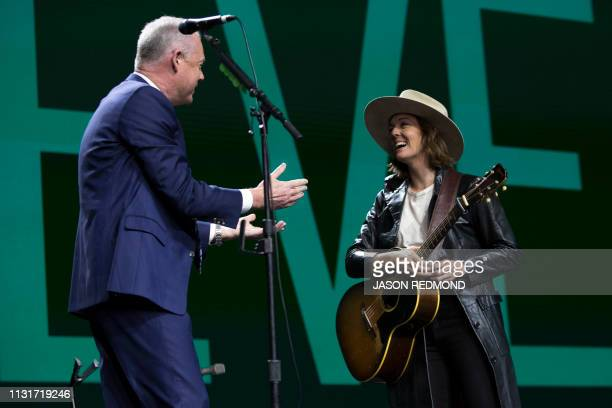 Starbucks President and Chief Executive Officer Kevin Johnson thanks Singer Brandi Carlile after her performance at the Annual Meeting of...