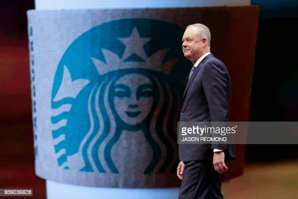 Starbucks President and Chief Executive Officer Kevin Johnson walks on stage at the Starbucks Annual Meeting of Shareholders at McCaw Hall in Seattle...