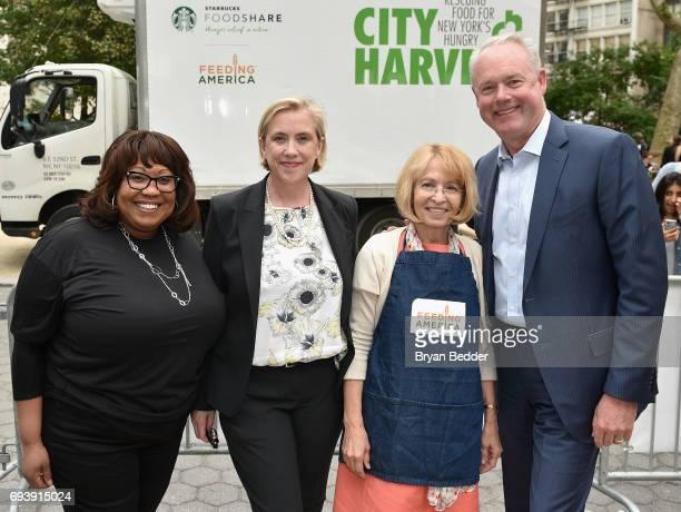 Starbucks Regional Director Carla Ruffin City Harvest CEO Jilly Stephens Feeding America CEO Diana Aviv and Starbucks CEO Kevin Johnson attend...