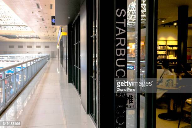 Starbucks shop in Beijing west railway station Starbucks is growing fast in China and aims to double its locations in the next five years to reach...