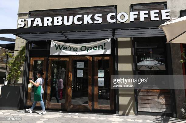 Starbucks worker prepares to clean the door at a Starbucks Coffee store on June 10, 2020 in Corte Madera, California. Starbucks announced plans to...