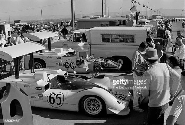 Stardust Grand Prix - Can-Am - Las Vegas. The Chaparral 2E of Phil Hill and Jim Hall draw a crowd of spectators in the paddock. The radical looking...