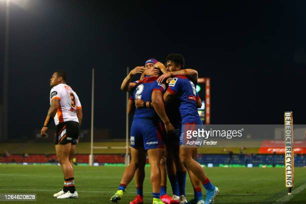 Starford To'a of the Newcastle Knights celebrates a try with team mates during the round 13 NRL match between the Newcastle Knights and the Wests...